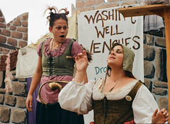 Myrtle is Entranced With the Interpreter's Sign Language - Shot on Film (Robb Wilson) Tags: renaissance irwindale renaissancefaire 2016renaissancepleasurefaire washingwellwenches bawdyhumor jokes signlanguage hearingimpairedinterpreter