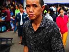 ,, Street, Laos ,, (Jon in Thailand) Tags: street pink man color green shirt mouth eyes nikon asia market expression cigarette streetphotography smoking vendor nikkor laos d300 morningmarket 175528 lpdr