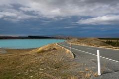 Dark Skys Ahead (Jocey K) Tags: road autumn newzealand mountains water clouds landscape highway scene hills southisland centralotago skys lakepukaki tripdownsouth mackenziebasin glacialfeed