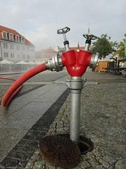 A hydrant (Aga Dzicio) Tags: hydrant water city square citycentre summer watercurtain splash red redness biaystok summerinthecity kurtynawodna rynekkociuszki