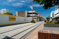 Street Markets have Moved (Jocey K) Tags: street trees newzealand christchurch sky signs architecture clouds buildings construction flags cranes buildingsite rebuild buildingsitehoarding terracedevelopment restartcashelmall