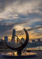Man Enters the Cosmos (Jeff Moore's Pics) Tags: park sunset sculpture chicago reflection water skyline night downtown cityscape afternoon shoreline lakemichigan shore grantpark lakefront