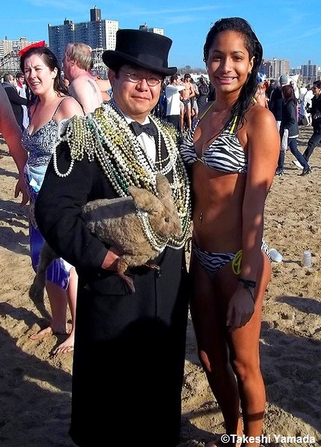 Dr. Takeshi Yamada and Seara (sea rabbit) at the Coney Island Beach in Brooklyn, New York on January 1, 2012. New Year Day Live Art Performance. Polar Bear Club, New Year Plunge. mermaids. 20120101 072=1010h==all