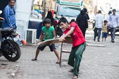 Street Cricket (AdamCohn) Tags: street india adam boys alley play swing cricket mumbai cohn adamcohn wwwadamcohncom