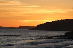 Puesta de sol (Cristina Camps) Tags: costa mar san playa paisaje cielo tomas menorca playas puestasdesol airelibre orilladelmar