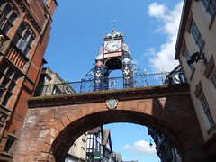 Eastgate Clock, 2016 May 23 (Dunnock_D) Tags: street uk blue england sky white clock clouds gate unitedkingdom britain pavement chester rows shops pedestrians eastgate