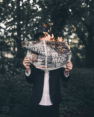 Playing with fire (Adam Bird Photography) Tags: uk light selfportrait leave hat paper fire newspaper politics fineart surreal eu suit flame 365 conceptual spark adambird adambirdphotography