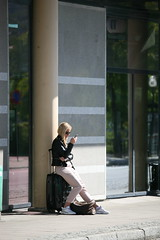 Waiting for the bus (LLysaght) Tags: passenger luggage waiting onphone busstation