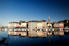 """on a hot summer afternoon the Old Harbour (Vieux Bassin) reflects itself to perfection, Honfleur, Normandy, France (grumpybaldprof) Tags: """"vieuxbassin"""" """"oldharbour"""" honfleur normandie normandy france """"quaistecatherine"""" """"quaiquarantaine"""" quai """"quaistetienne"""" """"stecatherine"""" """"lalieutenance"""" quarantaine water boats sails ships harbour historic old ancient monument picturesque restaurants bars town port colour lights reflection architecture buildings mooring sailing stone collombage halftimbered yachts bluesky blue sky summer hot reflections masts hoteldeville waterreflections church steeple slate gleaming marine maritime yellow warm tamron 16300 """"tamron16300mmf3563diiivcpzdb016"""""""