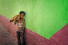 Boy and his chicken (departing(YYZ)) Tags: africa travel boy portrait people chicken tourism animal zeiss outside kid child sony young 55mm ay fe ethiopia alpha a7 harar sonnartfe55mmf18zalens