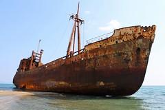Rusting... (Michael Kalognomos) Tags: sea beach water rust sink greece shipwreck ghostship gytheio