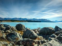 Lake Takepo New Zealand (mr_h0neybunny) Tags: landscape lake new zealand tekapo water rocks sky sun