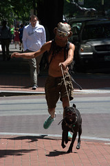 Choices (swong95765) Tags: city wild dog man crazy mask expression candid canine running sidewalk unusual charging