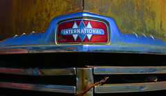 International (davidwilliamreed) Tags: old abandoned metal truck emblem rust decay neglected rusty grill international chrome forgotten weathered crusty petina