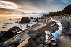 Driftwood on the Rocks ( SUNRISE@DAWN photography) Tags: sea wave driftwood rock beach seascape landscape sunset sundown afternoon cloud