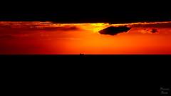 Shipping Between Night and Day (Photonenblende) Tags: sunset red sky orange black rot blackbackground d50 germany twilight nikon ship sonnenuntergang dusk highcontrast himmel balticsea rgen ostsee againstthelight tamronsp schwarzerhintergrund
