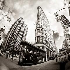 Flatiron Building II (Stefan K0n@th) Tags: street city nyc blackandwhite bw newyork building monochrome architecture square manhattan flatirondistrict peleng8mmf35 circularfisheye fujixpro1