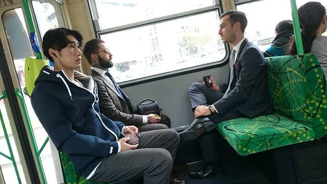 Neckbeard hipster with camera, hipster 2 with Axil Coffee takeaway cup, Asian dude with headphones