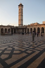 Sunset Umayyad Mosque An Afternoon in Aleppo, The Ancient City that Was October 31 2010 Syria Middle East (eriagn) Tags: travel art history tourism wool rock fruit architecture concrete religious photography wooden traffic citadel minaret traditional prayer religion middleeast streetphotography documentary mosque tourist tourists unescoworldheritagesite traveller textures syria souk historical produce bazaar dailylife textiles fortification moat fortress weaving income citizens aleppo hawkers syrian bathhouse suq shopkeeper marked beliefs ngaire ancientcity umayyadmosque orientalrugs camelhair medievalbuilding ceilingdecoration oldwalledcity citadelofaleppo traditionaltextiles eriagn ngairehart almadinasouq syrianstreetfood mpsqueinterior syrianpostbox
