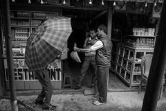 Umbrella, Yuksom Sikkim India (mafate69) Tags: street bw india men umbrella asia noiretblanc candid photojournalism documentary nb asie himalaya rue himalayas sikkim hommes inde reportage parapluie streetshot southasia subcontinent documentaire photojournalisme indiahimalayas photoreportage asiedusud blackandwhyte earthasia himalayasproject mafate69 souscontinent