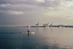 Rowing (Andrei Lazar) Tags: sky seascape beach clouds denmark harbor seaside sunny rowing aarhus