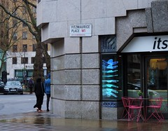 It's raining (Dun.can) Tags: street pink blue cold reflection london wet caf rain sign spring w1 berkeleysquare fitzmauriceplace