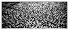 rail junction (madmtbmax) Tags: street city travel urban blackandwhite bw portugal stone view traffic stones lisboa tram eisenbahn rail symmetry junction cobble sw intersection lissabon schwarzweiss bahn solution permanent strassenbahn urbanarte