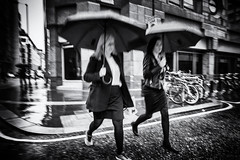 City Rain (Fuji and I) Tags: street city blackandwhite london monochrome rain umbrella alexarnaoudov