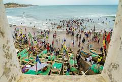 Cape Coast Beach Day (kevinwenning) Tags: africa castle window ghana party surf boats waves capecoast beach kevinwenning intentionallylostcom fishing wenning ocean crowd horizon