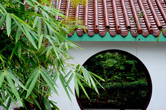 eaves and leaves (yolandayay) Tags: door city roof plants leaves architecture circle hongkong asia outdoor chinese kowloonpark