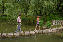 stepping stones 1 (stevefge) Tags: china shanghai people men women pond park water candid reflectyourworld