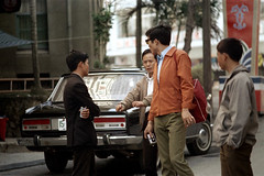 32-563 (ndpa / s. lundeen, archivist) Tags: nick dewolf nickdewolf 32 reel32 color photographbynickdewolf 1970s 1972 fall film 35mm winter republicofchina taiwan taiwanese china chinese people city citylife streetlife streetphotography street sidewalk men youngmen group car automobile man youngman glasses camera