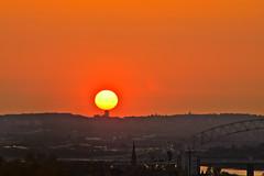 Balancing act (stumpyheaton) Tags: uk bridge sunset red england sky sun castle yellow night river outside golden nikon village cheshire cathedral hill rays nikkor 18200 mersey runcorn merseyside widnes halton d5100