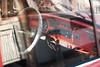 Volkswagen Beetle (borishots) Tags: volkswagenbeetle beetle buba vw car oldcar throughthewindow wheel red radio glass reflection sun light shadow canon canon300d 50mmf18ii 50mm krkojzla retro analog vintage colors pastel borishots
