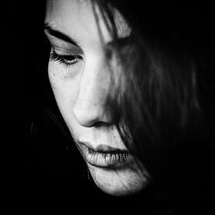 portrait (Merih Miran) Tags: light portrait blackandwhite woman monochrome beauty face closeup dark square sadness 50mm model nikon key mood loneliness low grain story feeling effect d300