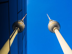 Twins [Explored] (Ulmi81) Tags: blue reflection berlin tower alex germany tv day tag olympus april fernsehturm ft blau funkturm spiegelung zuiko antenne antenna omd reflektion em1 2016 1454 alexanderplazt