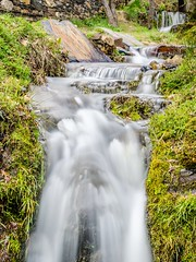 Flowing... (DanielSan_05) Tags: longexposure water 35mm spring spain guadalajara falls flowing pueblos negros valverde