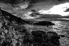 Coast (Costigano) Tags: sea sky bw seascape water canon eos coast rocks shore waterscape