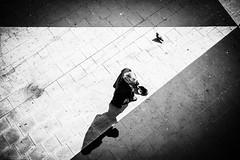 Cap in hand (.craig) Tags: street city travel shadow people urban blackandwhite bw birds contrast walking person pavement walk candid pigeons citylife explore