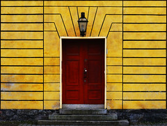 red door (TeRo.A) Tags: red yellow wall symmetry punainen ovi seinä keltainen symmetria