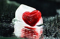 Only true love can nelt this ice cold heart (natus.) Tags: redheart ice drops blackbackground reflection cuore red wow brilliant
