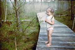 On the wooden walkway (batuda) Tags: wood trees color film nature girl leaves spring dof child kodak bokeh marsh zenit wetland c41 zenite dubrava colorplus200 mir1 migl fotopro