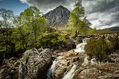 The big shepherd. (cliveg004) Tags: sun mountain clouds wow scotland waterfall highlands rocks glencoe rannockmoor buachailleetivemor rivercoupall