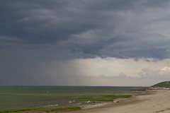 Thunderstorm Crossing (brucetopher) Tags: ocean sky cloud storm green beach water rain weather clouds grey bay coast waves gloomy wind gray dramatic front atlantic coldfront heavy storms seagrass seacoast heavyweather weatherfront amazingsky foulweather amazingskies weathermaker