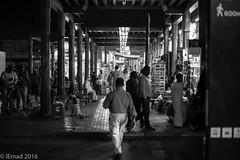 Shoppers and tourists... (EHA73) Tags: leica nightphotography travel blackandwhite bw tourism shopping dubai traditional uae streetphotography tourists souk deira bazar shoppers grandsouk leicamm aposummicronm1250asph typ246