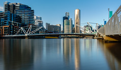 Yarra River Near Docklands (gazrad) Tags: city longexposure bridge blue colour reflection water horizontal modern river outdoors office flat contemporary smooth sunny australia nobody victoria calm highrise cbd cloudless
