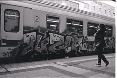 0003 (coloredsteel) Tags: street leica white black self 35mm graffiti stand kodak iso400 f14 trix rodinal developed m6 nokton trainspotting ulm voigtlnder developing trainwriting