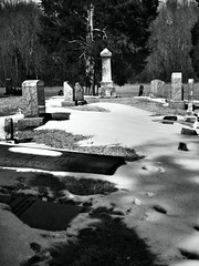 Southern Maryland Graveyard in the Snow #1. Taken with my Droid RAZR phone and processed with Snapseed and PicSay Pro. (CheverlyBob) Tags: camera winter blackandwhite bw snow monochrome cemetery graveyard phone headstone maryland southern android droid