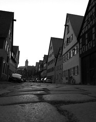 Low perspective (roomman) Tags: street old city blackandwhite bw white black streets history beautiful stone facade germany walking bayern bavaria evening town nice walk atmosphere scene medieval historic cobble cobblestone bandw 2015 dinkelsbühl