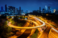 Highway (Patrick Foto ;)) Tags: road park street city travel blue light sky urban motion reflection building tower car skyline architecture modern night speed skyscraper way landscape asian hotel town office high asia downtown cityscape view apartment dusk top district petronas bank business trail malaysia bolt tropical symmetric kualalumpur residence highlight condominium recommended logistic my federalterritoryofkualalumpur federalterritoryofkualalumpu
